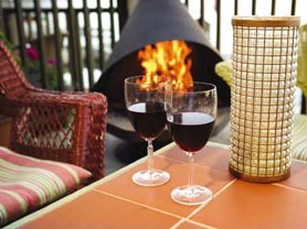 drinking wine on the deck patio fire pit