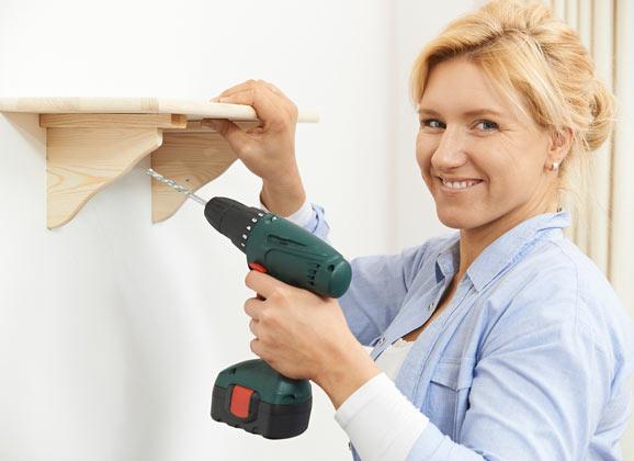 woman using power tools