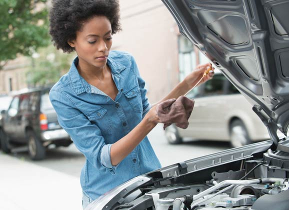 woman giving her car a tune-up