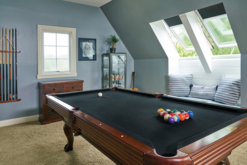 pool table in room with side sky lights