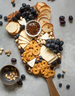 grapes as a garnish with cheese and crackers