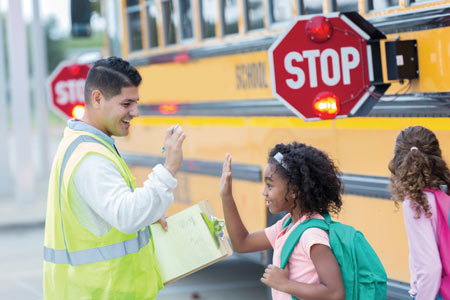school bus safety - kids with crossing guard