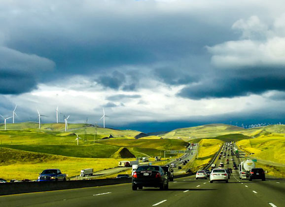 electic cars Evs on highway with wind power