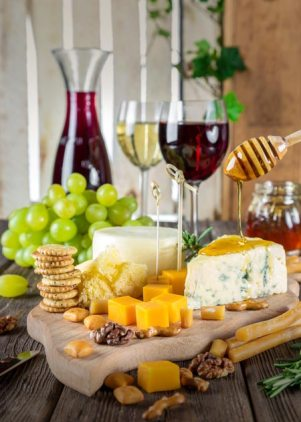 red and white wine with cheese, meat and honey