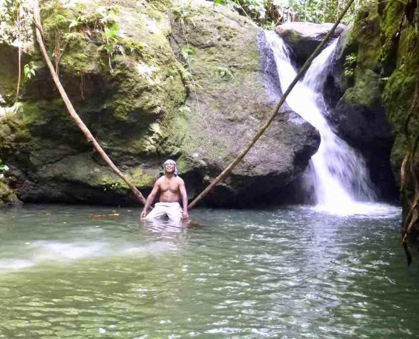 Playing Tarzan at a jungle lake