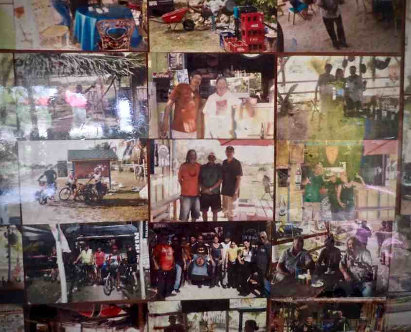 Bicycle touring through Belize - wall of memories at Slim'S bar and grill