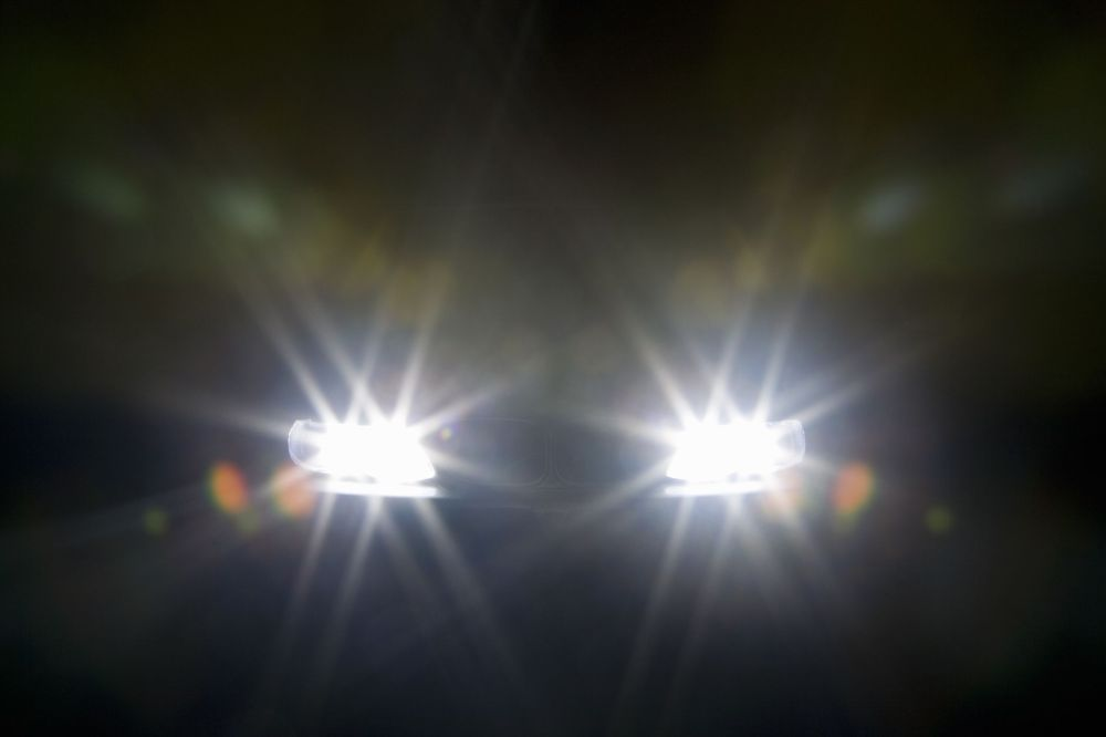 medium resolution of headlights glaring against dark background