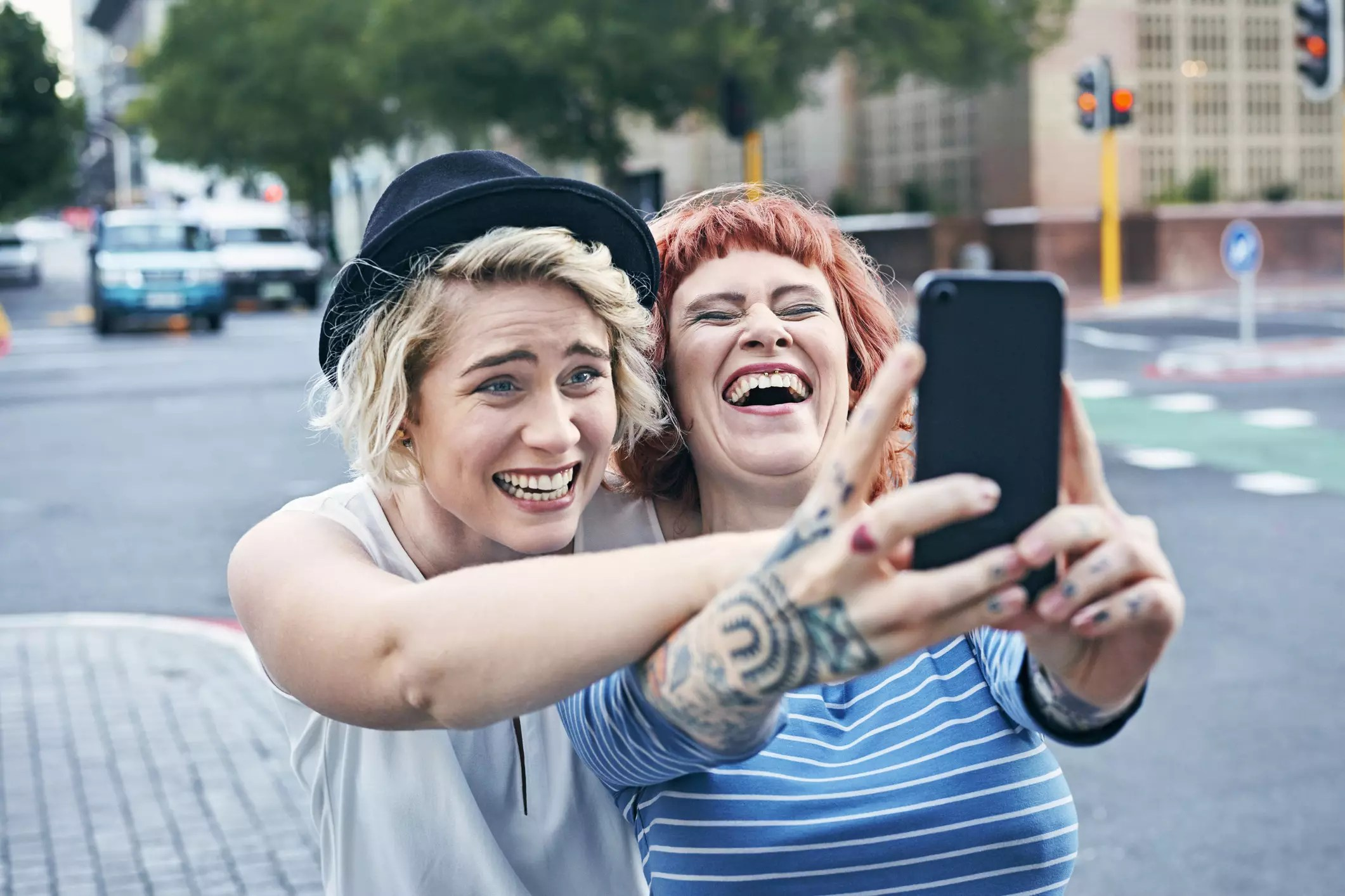 An image of two women laughing while taking a selfie