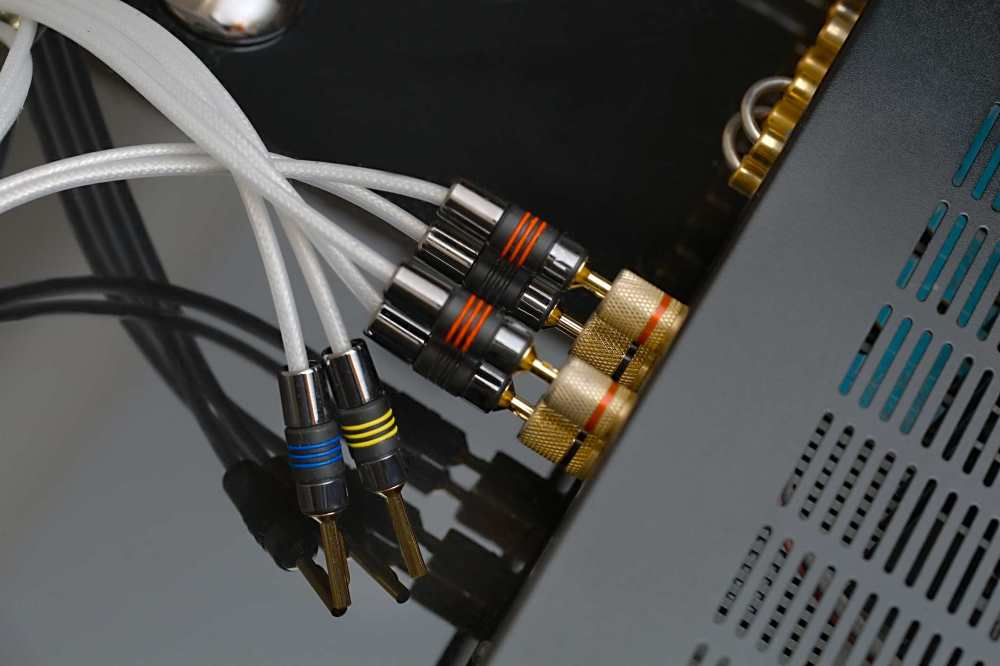 medium resolution of back of amplifier or reciever with cords going to speakers