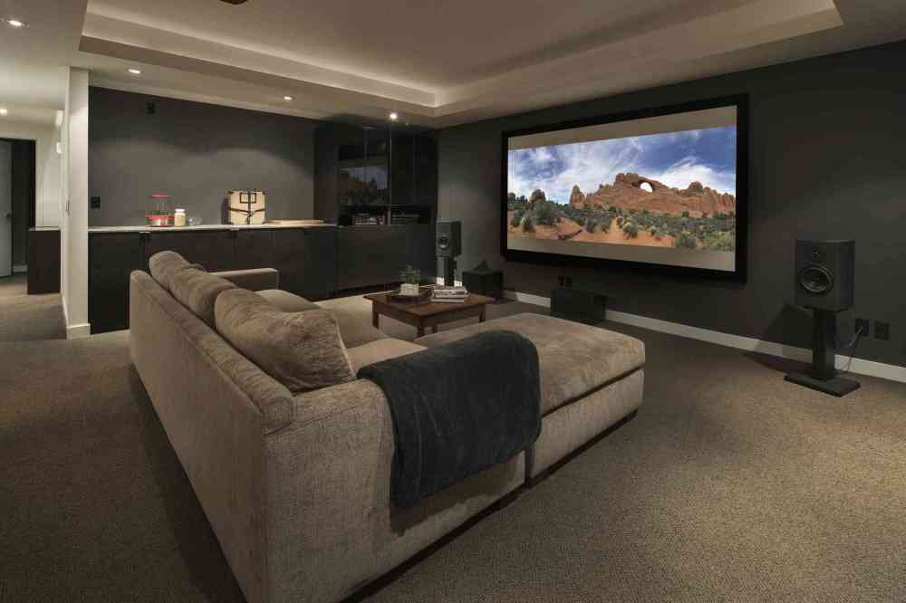 medium resolution of movie playing on projection screen in home theater