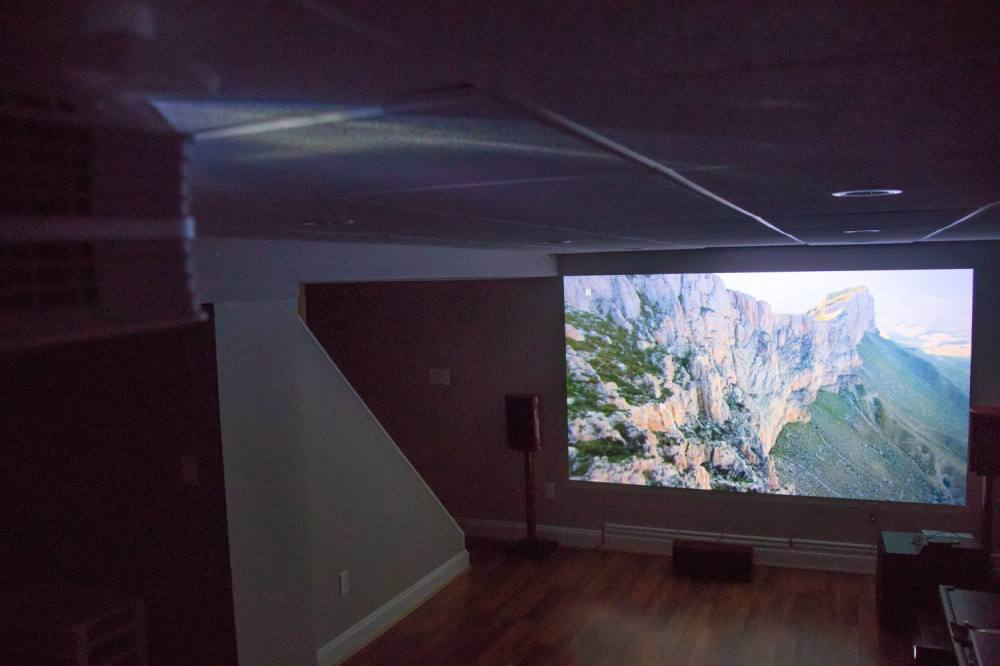 medium resolution of one tester who mounted his projector 10 feet from a wall in his basement commented the visual quality is much better than my 1080p projector the setup