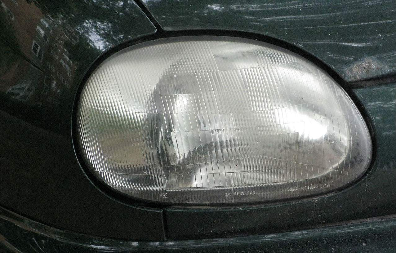 hight resolution of an oxidized headlight assembly that needs to be buffed and cleaned