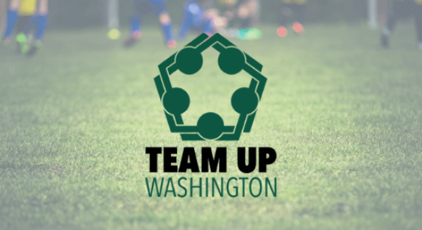 Team Up Washington Logo in front of a soccer field