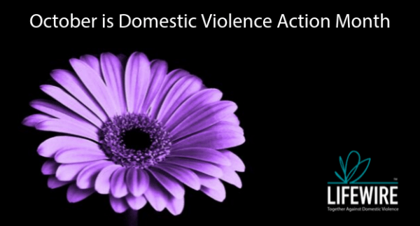 Purple flower on black background October is Domestic Violence Action Month