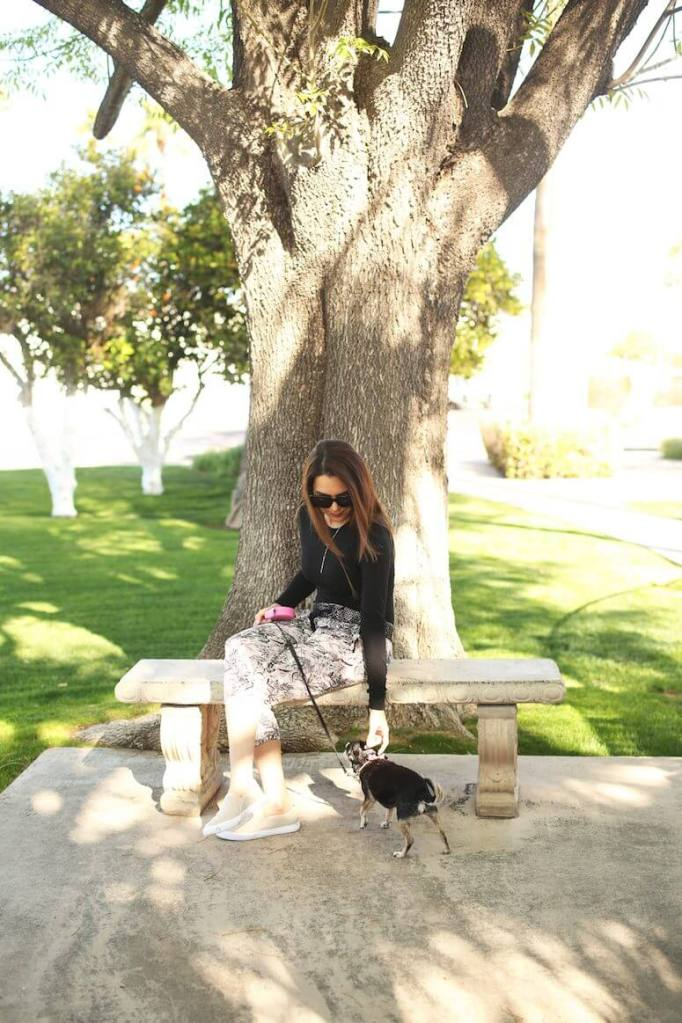 woman outside with chihuahua   how to stay energized as a mom