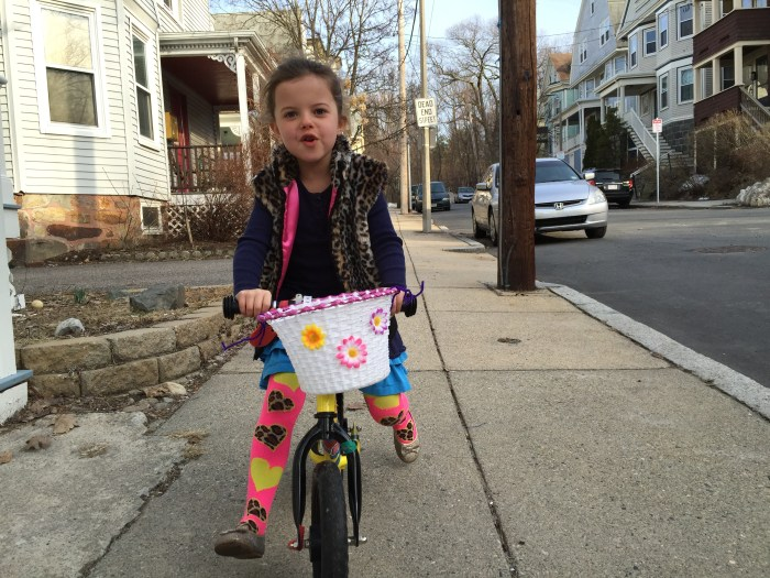 a girl and her balance bike