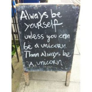chalkboard sign that reads be yourself or a unicorn