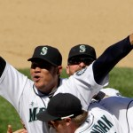 Seattle Mariners pitcher Felix Hernandez celebrates with teammates, including Justin Smoak (17), after throwing a perfect game in the Mariners' 1-0 win over the Tampa Bay Rays in a baseball game, Wednesday, Aug. 15, 2012, in Seattle. (AP Photo/The Seattle Times, Mark Harrison)  MAGS OUT; NO SALES; SEATTLEPI.COM OUT; MANDATORY CREDIT; USA TODAY OUT; TV OUT