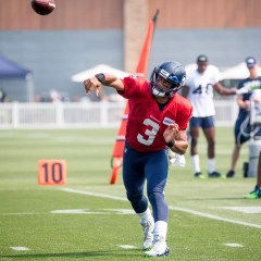 Russell Wilson throwing.