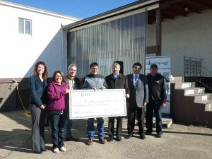 The Lighthouse team accepting funding from the BATC CDC.