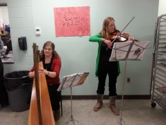 Volunteers providing music at Coffee House