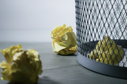wastebasket with crumpled up paper