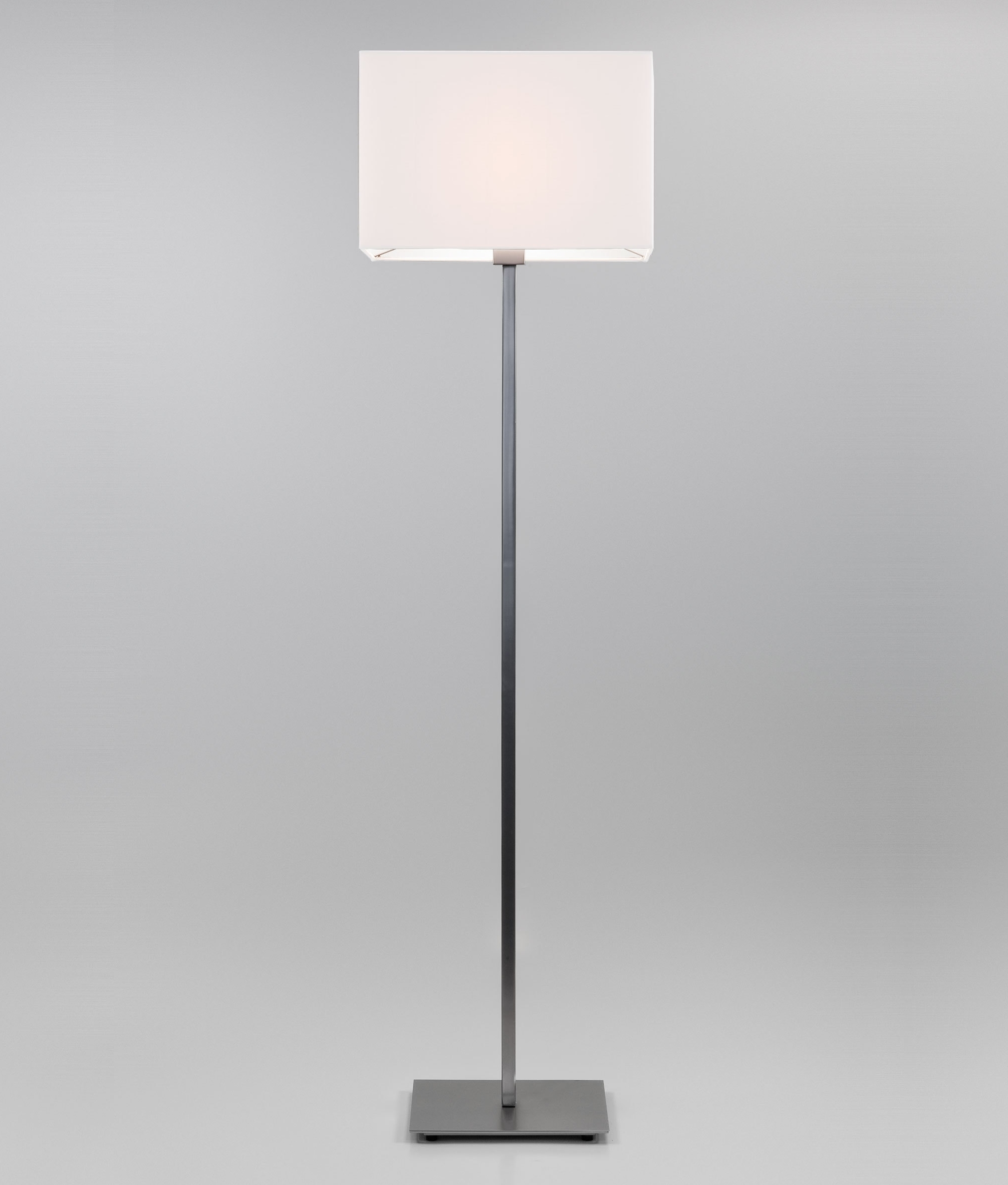 A floor standing lamp with a square stem and floor plate