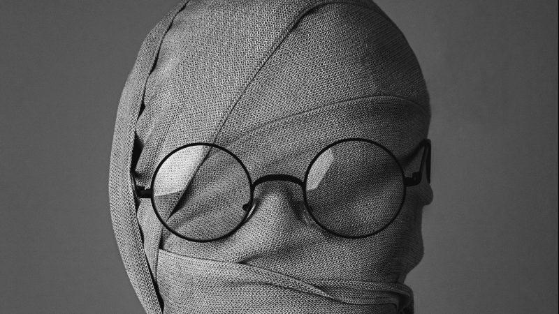 Mummy Wrapped Face with Glasses