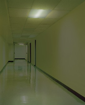 Corridor during power cut with emergency lighting in operation provided by a fluorescent emergency ballast. Image courtesy of Bodine.