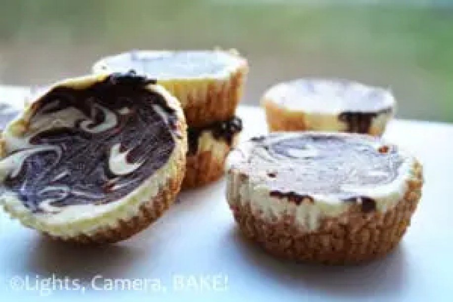 Mini Chocolate Marbled Cheesecakes. Decedent, creamy and so cute! These are surprisingly quick and simple to make. Click the photo for the #recipe . #minicheesecakes #chocolatemarbledcheesecake