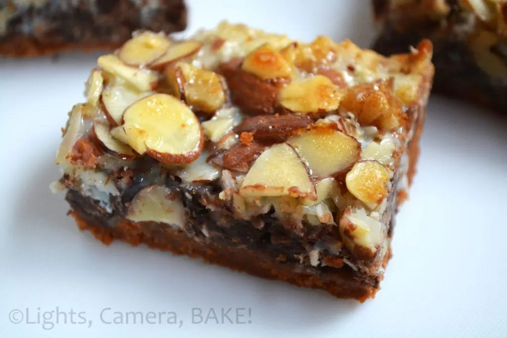 Magic Seven Layer Bars: Layer of crushed malted biscuits, melted butter, chocolate chips, coconut, nuts and condensed milk all baked to a sweet and sticky slice! Super delicious. #sevenlayerbars #magicbars #magicsevenbars