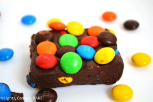 M&M Fudge. This fudge is an easy four ingredient, melt-in-the-mouth, chocolate fudge loaded with M&Ms! #mandmfudge #EasyChocolateFudge #M&MFudge