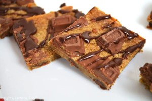 Whittakers Toffee Milk Chocolate Bars. Soft, dense and chewy toffee slice with chocolate chips and Whittakers Toffee Milk Chocolate pieces throughout. Topped with more Whittakers Toffee Milk Chocolate pieces and melted chocolate! Recipe on Lights, Camera, BAKE! #WhittakersToffeeMilkBlock #toffeebars #chocolatetoffeeslice #softtoffeebars #milkchocolatebars