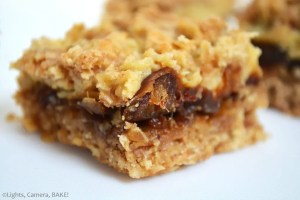 Caramel Date Oat Bars are a crunchy, lightly spiced coconut pat base and top with a layer of buttery caramel and soft dates in the middle. Super yum, sweet and a perfect mid morning treat or dessert. #carameldatebars #carameloatbars #datecaramel