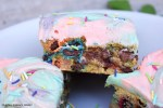 Unicorn Cookie Bars are soft, gooey and chewy cookie bars packed full of sprinkles, M&Ms and chocolate chips topped with a funfetti buttercream. #unicorncookiebars #rainbowbuttercream #cookiebars #funfetticookiebars #funfetticookies #m&mcookiebars