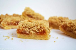 Apricot Shortbread Crumble Slice is a melt in the mouth shortbread base topped with tart apricot jam filling and finished off with a simple crumble top. Its sweet, tart and refreshing. Perfect for dessert or a sweet treat with your morning coffee.