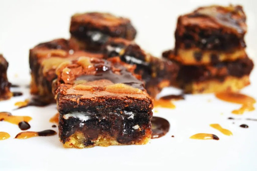 These slutty brownies 2.0 combine the cookie dough base, Oreo middle and fudge brownie top just like the original but we then add a homemade caramel sauce and homemade hot fudge sauce right there in the middle with the Oreos. Oh yes! Totally unnecessary to some people but we're not included in that group are we?