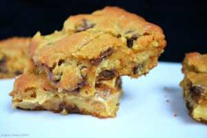 Caramel Chocolate Chip Cookie Bars are a soft, chewy and ooey gooey chocolate chip cookie baked in a slice pan with a thick layer of sweet and buttery caramel running through the middle.