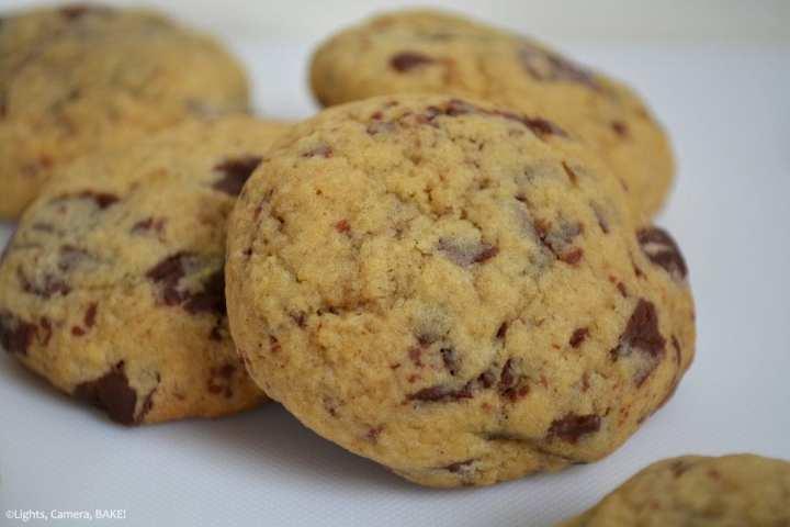 REAL Chocolate Chocolate Chunk Cookies. A pile of the chocolate chunk cookies on a white surface
