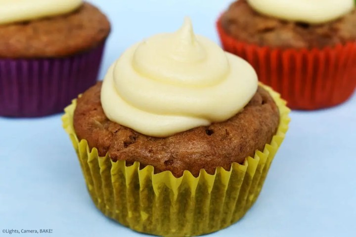 Raspberry Banana Cake Cupcakes with Cream Cheese Icing close up of the cupcakes with the yellow cupcake case