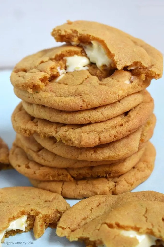 White Chocolate Stuffed Butterscotch Cookies. Chewy butterscotch pudding cookies packed full of white chocolate for a melty, gooey middle. These use a butterscotch pudding mix to give the strong butterscotch flavour and to add chew to the cookie. #butterscotchcookies