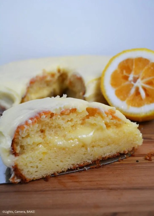 Lemon Yoghurt Cake is a light, moist, fluffy and refreshing lemon cake with a sweet and perfect cream cheese icing. #lemonyoghurtcake #lemoncake #lemonrecipes #lemoncakerecipe #lemonyoghurtrecipe #creamcheesefrostingrecipe