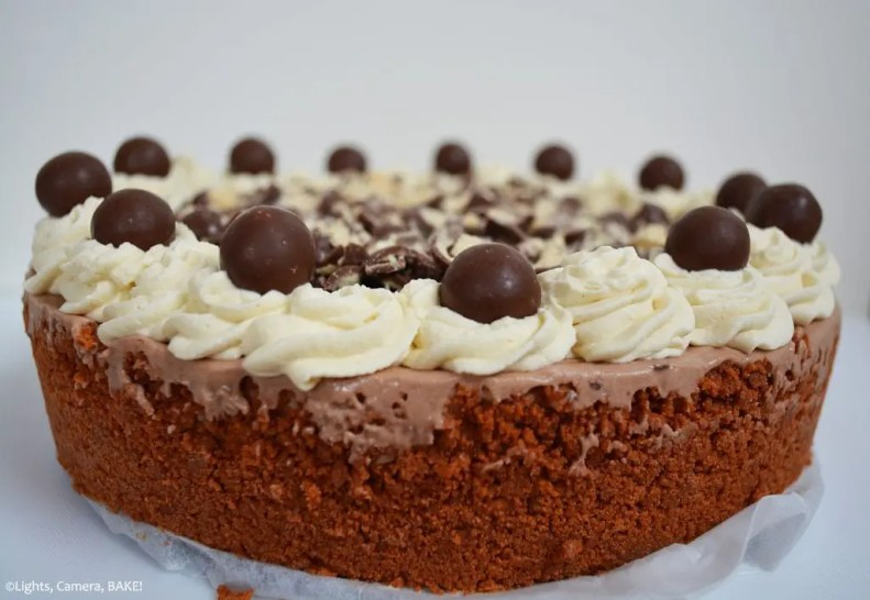 Malteser Cheesecake is a no bake malt chocolate cheesecake on a malted cookie base and topped with Maltesers and a Malteser chocolate spread. An easy cheesecake that doesn't require an oven and tastes like a Malteser in cheesecake form! #cheesecakerecipe #nobakecheesecake #chocolatecheesecake #nobakechocolatecheesecake #maltesercheesecake #maltesersrecipe #maltchocolate