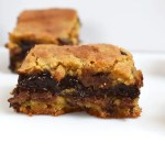 Chocolate Fudge Stuffed Cookie Bars are soft and gooey cookie bars with a quick and easy chocolate fudge running through the middle.#chocolatefudgecookiebars #chocolatefudge #easychocolatefudge #fudgecookiebars #chocolatechipcookiebars #cookies #chocolatechipfudgecookiebars