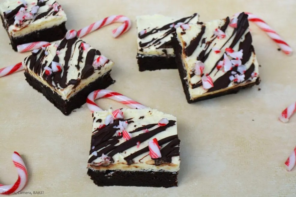 Christmas Peppermint Brownies are rich, dark chocolate, fudgy brownies, topped with a peppermint icing, a drizzle of peppermint chocolate ganache and pieces of candy canes. #christmasbrownies #christmasrecipe #christmasbaking #peppermintbrownies #christmaspeppermintbrownies #candycanebrownies