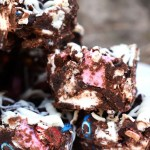 Cookies and Cream Rocky Road is packed full of Oreos, cookies and cream chocolate, M&Ms, marshmallows and then smothered in melted chocolate. This is simple, no bake and takes just five minutes to make. #cookiesandcreamrockyroad #oreorockyroad #cookiesandcreamfudge #easyrockyroadrecipe