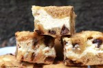 Cheesecake Cookie Bars are soft and gooey chocolate chip cookie bars with a sweet and creamy vanilla cheesecake swirled through the middle! #cheesecake #cookiebars #cheesecakecookies #cheesecakecookiebars #chocolatechipcookiebars #gooeycookiebars