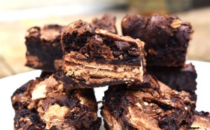 KitKat Brownies are rich and fudgy brownies filled with copious amounts of KitKats. We have two full KitKat blocks running throughout these brownies! #kitkats #kitkatbrownies #fudgybrownies