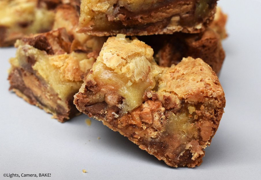 Peanut Butter Cup Blondies are white chocolate blondies filled to the brim with chocolate chips, roasted peanuts, Reese's Peanut Butter chips and Reese's Peanut Butter Cups for the Reese's lovers out there. #peanutbuttercups #peanutbutterblondies #whitechocolateblondies #peanutbuttercupblondies