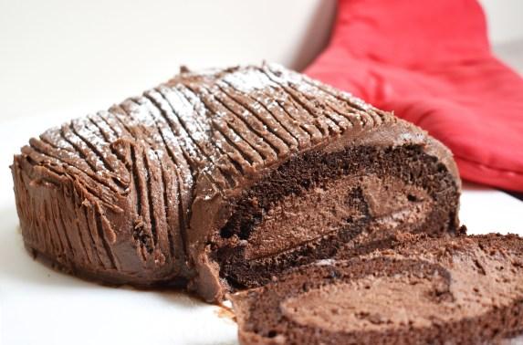 Chocolate Yule Log is a classic Christmas recipe that takes a sponge roll cake and turns it festive! #chocolatespongeroll #yulelog #chocolateyulelog #yulelogcake #fatlessspongerecipe